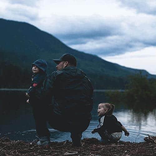Man And Children At Lake Edge