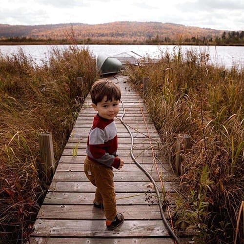 Young Boy On Wharf At Lake